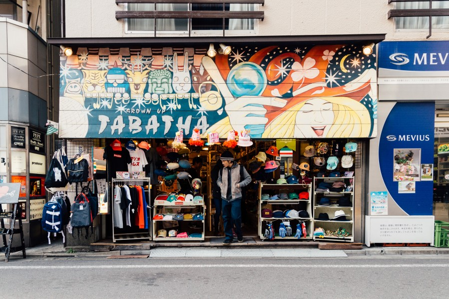 Tokyo, Japan - Mar 21, 2016: A male walking out of an apparel shop in Shimokitazawa. The district is famous for independent fashion shops, cafes, decorations, and theaters.